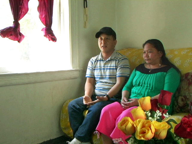 Bhutanese couple at home on their couch