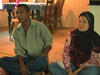 Couple from Burma talking at home