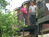 Couple talking on their balcony
