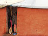 Congolese in doorway in Gihembe camp in Rwanda