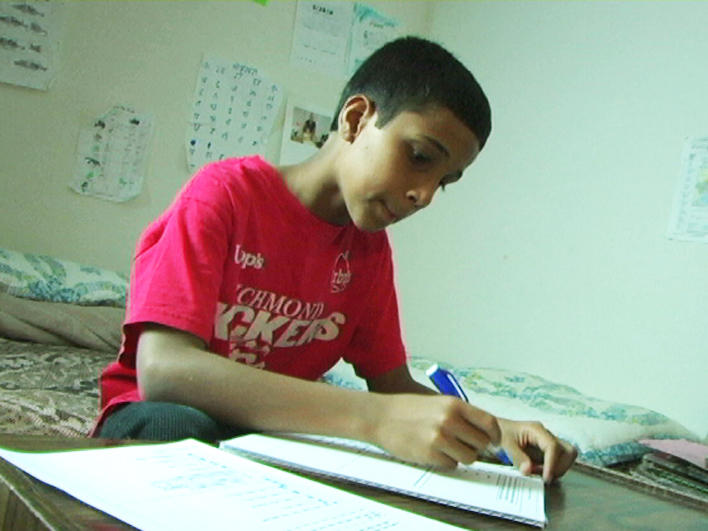 A Bhutanese boy doing homework