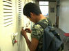 Boy from Burma opening his school locker