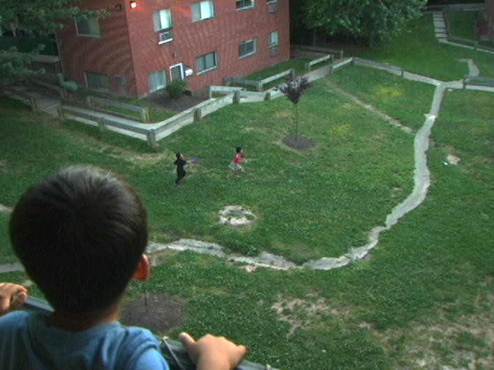 Children from Burma playing in courtyard