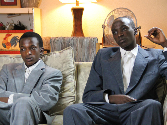 Congolese boys sitting on a couch