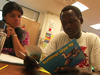 Darfuri boy reading in English at school