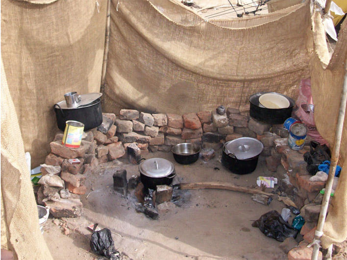 Cooking facilities in camp where Darfuris live in Chad