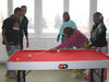 Somali refugees playing pool during a CO session break