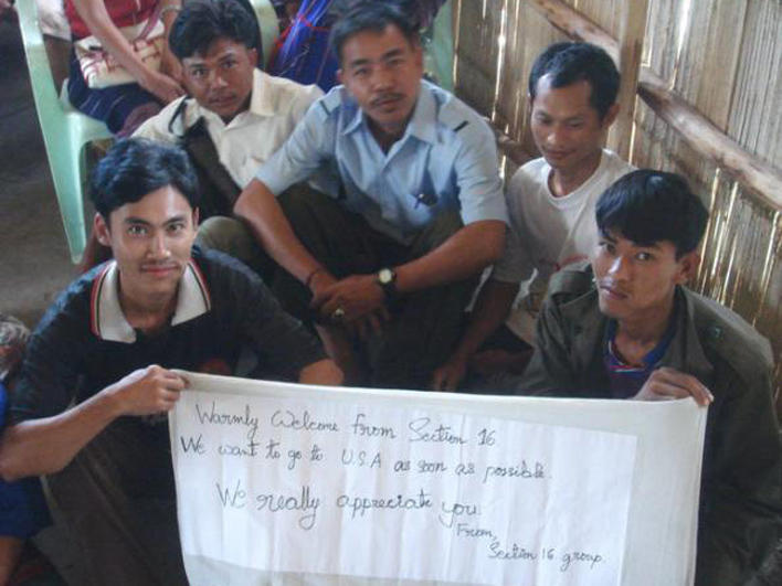 Refugees holding an appreciative note