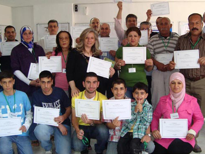 CO class attendees with certificates of completion