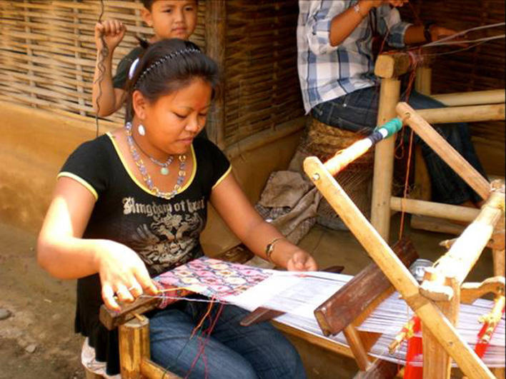 Woman weaving in the refugee camp